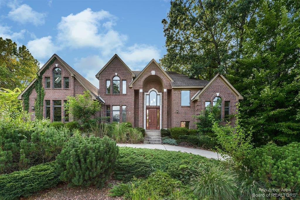 Custom built brick home in prestigious Hidden Paradise. Upgrades throughout: 1st floor master bedroom with fireplace, jetted tub, stand-up shower, & walk in closet. Formal dining room & butler's pantry. Custom kitchen w/ granite countertops & Viking stainless steel appliances, including a double oven. Foyer/great room with soaring ceilings & stone fireplace. Other amenities on the entry level include laundry room & office with vaulted ceilings. Upstairs are spacious bedrooms with a loft area, perfect for another bedroom or office space. Furnace & central air new in 2019. 3/4 acre treed lot with pond, walkout basement plumbed for bath, circular driveway, & 3 car garage. This one is truly one of a kind, the dream home you've always been waiting for. Seller can grant immediate occupancy, so you can settle your family before the school year!