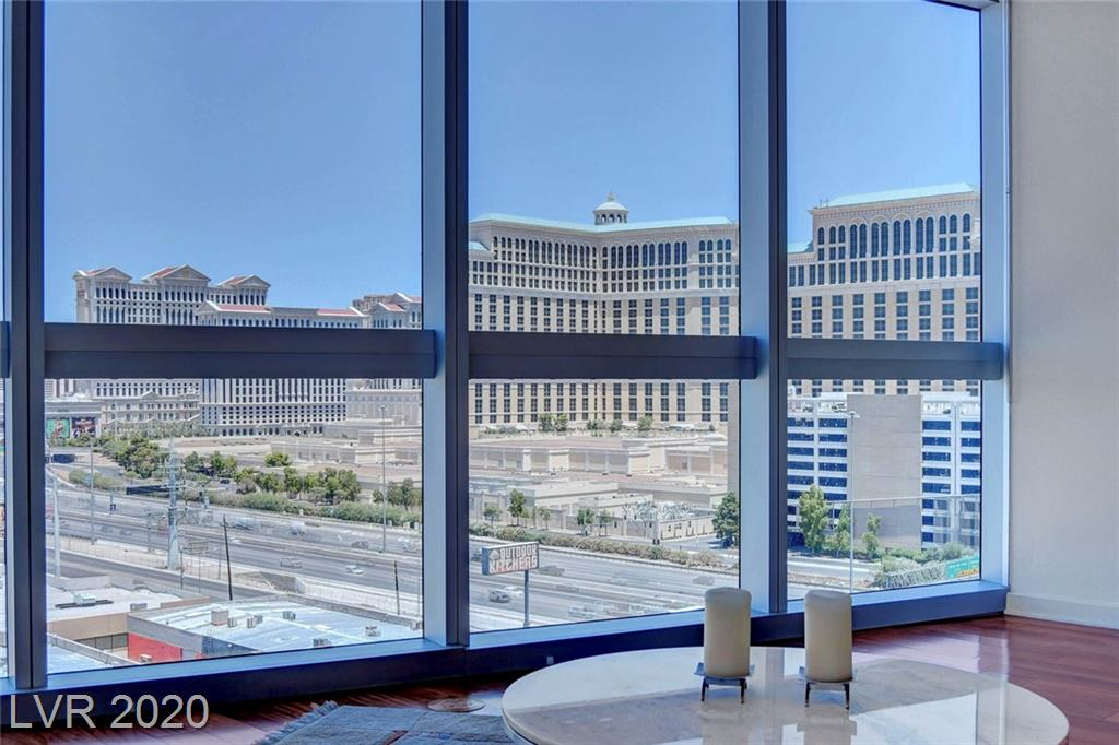 """HIGHLY SOUGHT AFTER Corner Furnished 1 BR/1BA """"J"""" Plan at The Martin with 180 Degree Views of the Las Vegas Strip, Mountains, & Desert Sunset Skies! Walls of Floor to Ceiling Windows Surround the Great Room! Sleek Built in Murphy Bed! Kitchen Features Kashmir Granite Counters, Stainless Steel Appliances, & Soft Close Cherry Cabinetry. Absolutely Gorgeous Hardwood Wood Floors! Luxury Master Bath w/ White Carrera Marble Floors & Countertops, Separate Tub & Shower! Huge Oversized Balcony! This condo conveys with use of a storage unit. This is one of THE nicest & most appealing 1 BR Floor plan you will find in Las Vegas High Rise Living! The Martin amenities include pool, fitness center, indoor spa, locker rooms, library, business center, Driver Service & Mini Sundry Shop. HOA dues include basic Centurylink TV & internet. A 5 min Walk to Aria/Cosmopolitan via the Harmon Overpass makes The Martin one of the BEST locations!"""