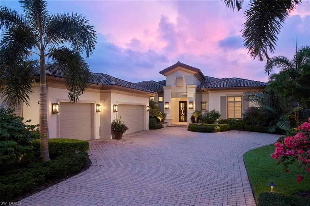 Rarely does a newer construction home come on the market with this level of custom detail in the desirable Miramonte neighborhood inside Grey Oaks. The over 3,700 square foot three-bedroom plus den home with interiors by Godfrey Design, including exquisite draperies by Michael Schmidt, was crafted in 2015 by Gulfshore Homes and includes an inviting open floor plan with gourmet kitchen including plenty of storage along with large island, Blanco Silgranit sink, Wolf and Sub-Zero appliances.  The outdoor living space leaves nothing to be desired and features a large lap pool with raised spa and adjustable speed resistance swim jet, a spacious covered lanai complete with bar, outdoor kitchen with gas grill, fireplace and motorized hurricane shutters. A gas generator, climate-controlled custom wine cellar, porcelain travertine-style tile, white oak wide-plank flooring, attached 3-car climate-controlled garage with additional walk-up storage rooms above the garage, Encore epoxy floor and cabinetry plus secondary washer and dryer are just a few of the additional features too numerous to name here. A world of luxury awaits you inside the private, gated community of Grey Oaks Country Club.