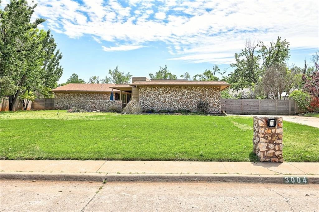 Beautiful Mid-Century Modern Quail Creek home with 3 bedrooms, 2.5 bathrooms, a study, and just over 2,500 sq. feet. An entertainer's dream! Home features a covered porch with an open deck courtyard and an additional open patio in the backyard. Upon entering, you will be greeted with beamed high ceilings in the spacious sunken living room with new flooring, an updated fireplace, and a wet-bar built-in. Gourmet kitchen-dining combo with gorgeous quartz countertops, updated backsplash, recessed lighting, and ample cabinet space. Formal dining room with updated fixtures. Large master suite with a private patio and three closets (one walk-in closet). Tons of natural light throughout the home and ceiling fans in each bedroom. Open patio in the fully-fenced backyard. Close to schools, shopping centers, all major highways, and more. Welcome home!