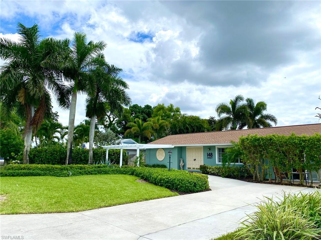 A rare jewel in the charming community of Bonita Shores, free of HOA fees, gates and strict rules, where streets are numbered and friends are countless, this three bedroom home looks out over a natural pond with a fountain and a parade of visiting birds. Updated yet maintaining the comfortable style that features a poolside lanai, bridging the indoors to outdoor entertainment. Sleeping areas are separated to welcome guests while providing privacy. An efficient layout makes this a perfect setting for southern living. Add to this, the deeded access to a boat launch nearby and the feature of a community center with an appealing calendar of social activities, this home is treasure to be discovered. Collier county Schools and low taxes.