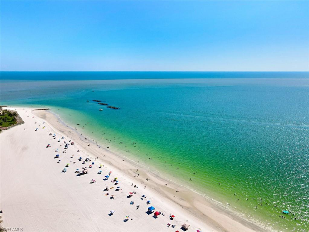 C.17780 - Rarely available condominium with STUNNING VIEWS of the turquoise waters of the Gulf of Mexico from many vantage points, roughly .5 miles to closest BEACH ACCESS and for the investor, enjoy the opportunity for WEEKLY RENTAL INCOME if so desired. Open floor plan with split bedrooms and in-residence washer/dryer from this nicely decorated home.  Community pool and tennis courts are centrally located to the unit.  In addition to a short stroll to the pristine white sandy beach, the condominium is also a short stroll to fine and casual dining, theater, and shopping.  Don't miss your chance to own this  rare gem of a condominium boasting stunning views, desirable beach location, and weekly rental income.