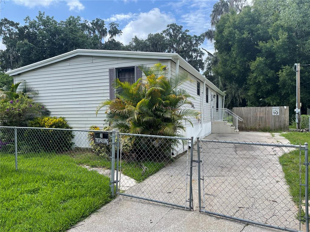 Welcome to Brandon, one of the most sought locations in the greater Tampa area. Best of all NO HOA and NO CDD fees! New Roof only 1.5 years old! New AC replaced in 2014! This double wide mobile has 3 bedrooms and 2 bathrooms. As you walk in you're greeted with high vaulted ceilings and a lot of open space in the family room. Nice vinyl throughout the home. Through the family room there's quick access to the kitchen which offers plenty of cabinet and counter space as well as all appliances included. Across from the kitchen there's the dining room which sits separate from the large living room. Bedrooms are spacious and the master offers a large walk in closet. Property has a long carport and access to the backyard great for pets and outdoor entertainment. Located minutes from Highway 60 and I-75 allowing easy access to shopping, restaurants, schools, Tampa, the Tampa international airport and Macdill AFB.