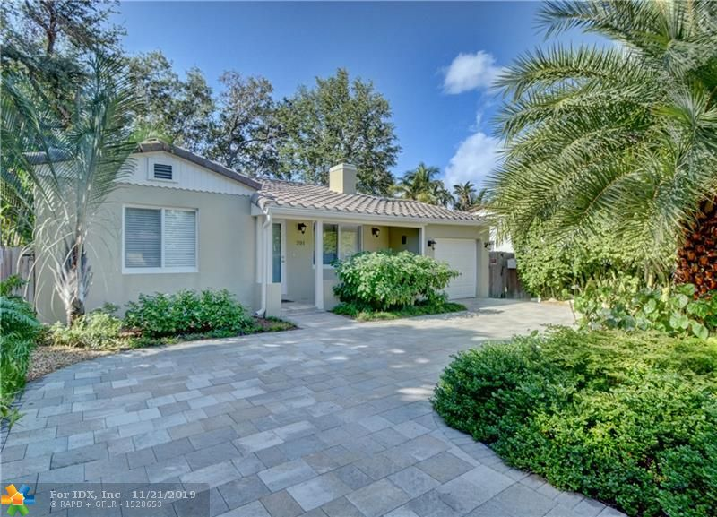 Tastefully updated single family home with a beautifully appointed cottage ideal for guests or Airbnb. Circa 1937 with hardwood floors, Dade County Pine vaulted ceilings, wood burning fireplace and natural gas. The many upgrades include impact windows & doors, updated kitchens & baths, stainless appliances, plumbing, electric, gas tankless water heaters, newer A/C, & roof, fence, pavers & salt chlorinated pool with gas heater. The pool is situated between the house and cottage creating an amazing backyard showcasing a custom waterfall and lighting feature that creates the tranquil ambiance. Lush landscaping with majestic oak trees, palms and other tropical foliage, creates a totally private enclave.  A tropical oasis in the heart of Victoria Park!