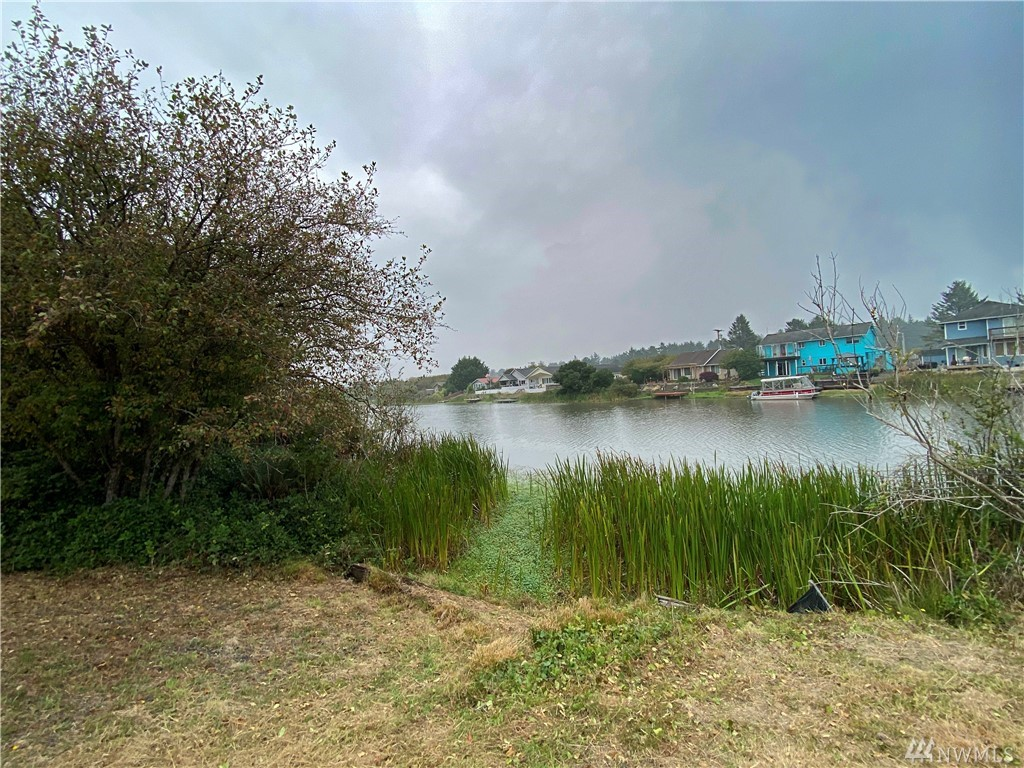 Two beautifully cleared waterfront lots located on the grand canal of Ocean Shores with grandfathered in boat launch already installed. Build one house in the middle of the two lots or build two separate homes. You can also camp 90 days a year and there is water, sewer, and power in the street ready for easy hook up. This property is close to the beach, downtown, and lots of fun things to do. Enjoy surfing, fishing, clamming, and hiking in this awesome beach town. LID's paid in full.
