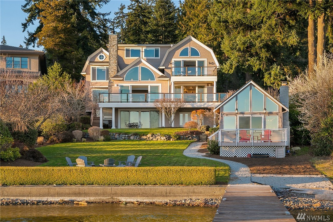 Sensational waterfront estate w/panoramic SW Lk WA, Mt Rainier & sunrise/sunset views! Hamptons style home w/full 2012 remodel inclg new kitchens, baths, plumbing, elec, windows, roof, siding, stone, tile & hdwds. Light-filled 6,390SF 5BR 5.5BA main house w/gourmet chef's kitchen - Wolf, Miele & Sub-Zero. Mstr BR w/spa BA, 3rd flr flex rm, 2nd kit, & 440SF ADU. Magnificent 28,657 SF lot, 75' of wtft, w/lawn to fire pit & beach, 86' dock w/huge moorage, two 3 car garages. True signature property!