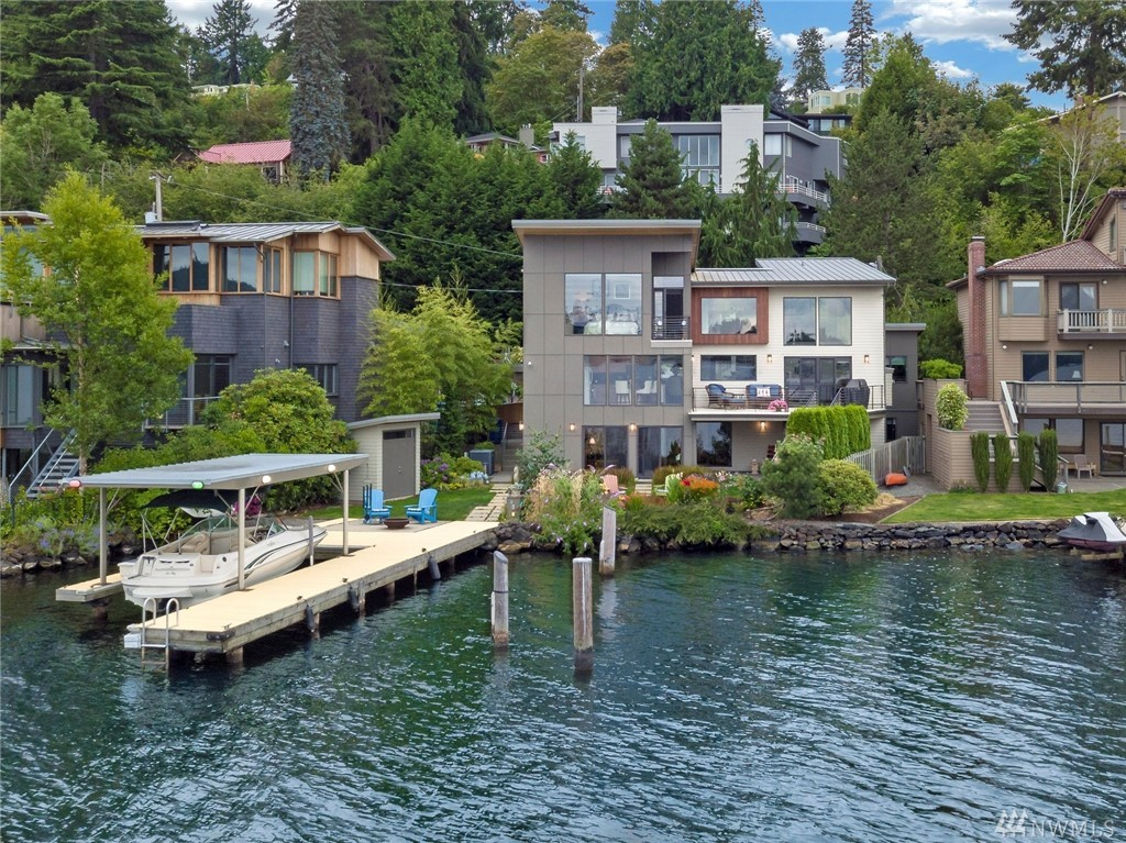 NEW PRICE ALERT on this Summer Stunner! Enjoy this awe-Inspiring modern masterpiece. Perfectly situated on 60' of Lk Washington w/ Rare deep moorage & covered boat lift and dedicated Shore Power right at dock. New Steps for easy launch of Kayak/SUP. High-end amenities throughout for lake living at it's best. Main Floor boasts open concept, walls of windows and vaulted ceilings. Top floor is Master retreat w/ lounge/office space. Walkout entertainment level with wet-bar & two beds w/full bath.