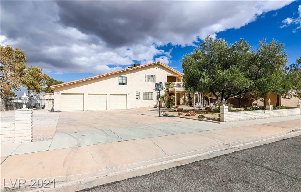 SPECTACULAR HOME WITH A FULLY FINISHED BASEMENT, ADDING NEARLY 900 SQ.FT MAKING THIS HOME OVER 4,500 SQ.FT ON AN ALMOST ONE ACRE ESTATE!! A BACKYARD THE WHOLE FAMILY CAN ENJOY INCLUDING AN OVERSIZED POOL  & SPA WITH PALAPA, AN INGROUND TRAMPOLINE, PUTTING GREEN, BATTING ENCLOSURE ALONG WITH MATURE LANDSCAPING AND STRIP AND MOUNTAIN VIEWS! THE BASEMENT IS SOUND INSULATED WITH BUILT-IN CABINETRY & A WETBAR ALONG WITH A POOL TABLE AND PING-PONG TABLE TOO! SOUTHERN NEVADA LIVING  AT IT'S BEST!