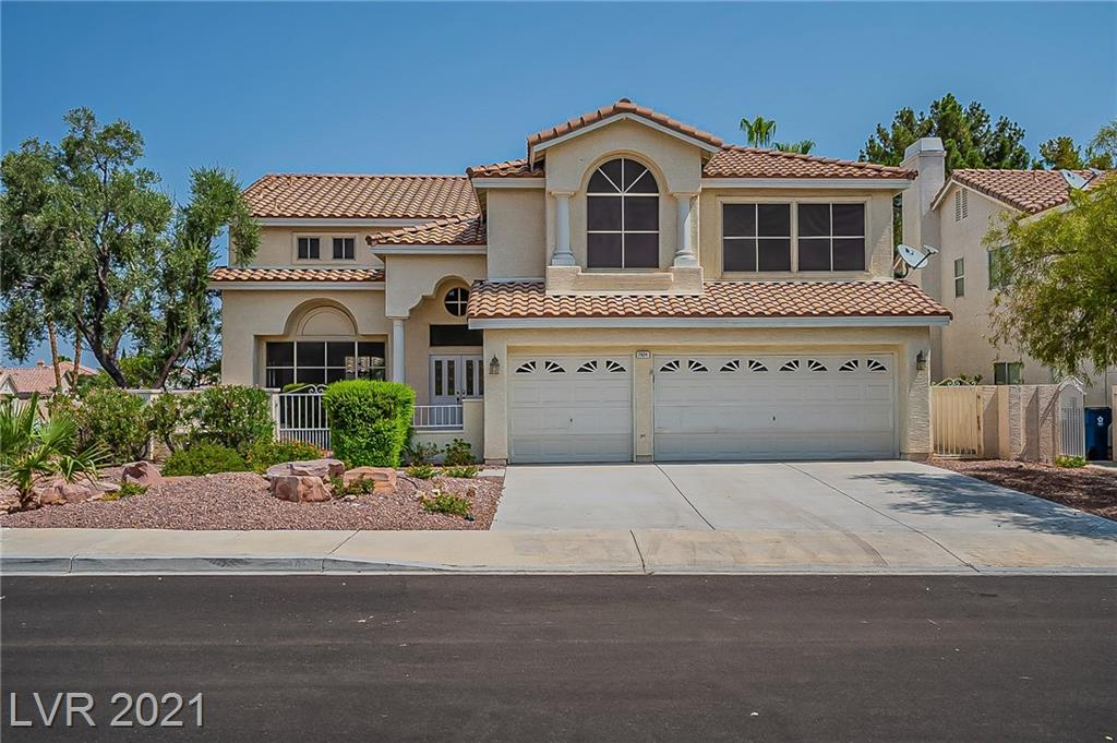 This Las Vegas two-story cul-de-sac home offers granite countertops, and a three-car garage.