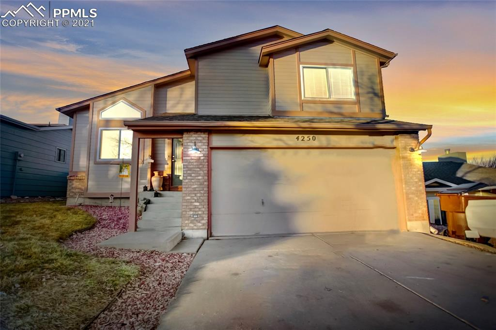 Updated 4 bed 2 bath 2 car home w/ RV PARKING near Powers corridor*BRAND NEW KITCHEN w/ white cabinets, vinyl flooring, eat in kitchen w/ bay window*CENTRAL AIR*Vinyl windows*new roof 2017*updated flooring*main level has LR w/ vaulted ceiling, eat-in kitchen*lower level FR w/ GAS FP, built-in cabinets & walk-out to covered patio & fenced yard*upper features large Master bedroom w/ adjoining 3/4 bath, 2 additional bedrooms and full bathroom*Bsmt features spacious bedroom w/NEW luxury vinyl plank flooring, laundry, rough-in