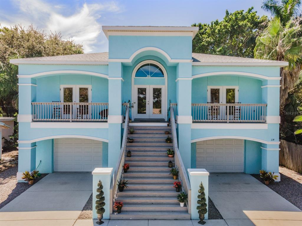 """BOATERS & BEACH LOVERS PARADISE!  Get the BEST of both with this CUSTOM built 2018 Home situated midway between the Gulf Beaches and Intracoastal Waterway in upscale BELLAIR BEACH!  Just a few homes to the East, at the end of this well maintained residential street off Gulf Blvd, is the private Boat Ramp/Dock access AND just a few homes to the West, one street over, is your Resident Private Beach Access.  Park your Boat, jet skis, kayaks, paddleboards, trailers, vehicles, bikes & all your toys in this Spacious 2000 sq. ft. 6 car garage with rear garage door to drive thru!  Grand Stairway Welcomes you with Florida CHARM to the Spacious Front Porch with Double Glass Entry doors into the Foyer. Once inside, Ceramic Tile on the Running Bond greets you & ushers you thru this 4 bedroom, 3 full bath  home with Crown Molding and Casual Elegant Interior! Great Room boasts Gas Fireplace as focal point with display shelves on either side and is OPEN to the Formal Dining area and Gourmet kitchen, with Triple Sliders to your private Back deck to extend the entertaining space! Stunning Kitchen boasts 42"""" Warm Wood Cabinets with Crown, Gleaming Granite counters, Classic subway tile backsplash, Gas range with pot filler and hibachi additions, Wine cooler and Bluetooth compatible Black Stainless Appliances and HUGE Walk in pantry (which could be an elevator if installed in the future as stairwell was designed to house an elevator). Double door entry to your Romantic Owners retreat with recessed double tray ceiling and french doors open to your private balcony, to relax and take in the Seabreeze! Luxurious bath ensuite boasts soaking tub, dual vanities with granite tops, vanity area, spacious separate shower with dual shower heads and expansive closet with chandelier! Guest bedroom and bath are on a separate wing with french doors opening to private balcony for a peaceful view. 3rd bedroom is set up as a nursery boasting a custom airplane mural with rotating propeller! 4th bedroom is"""