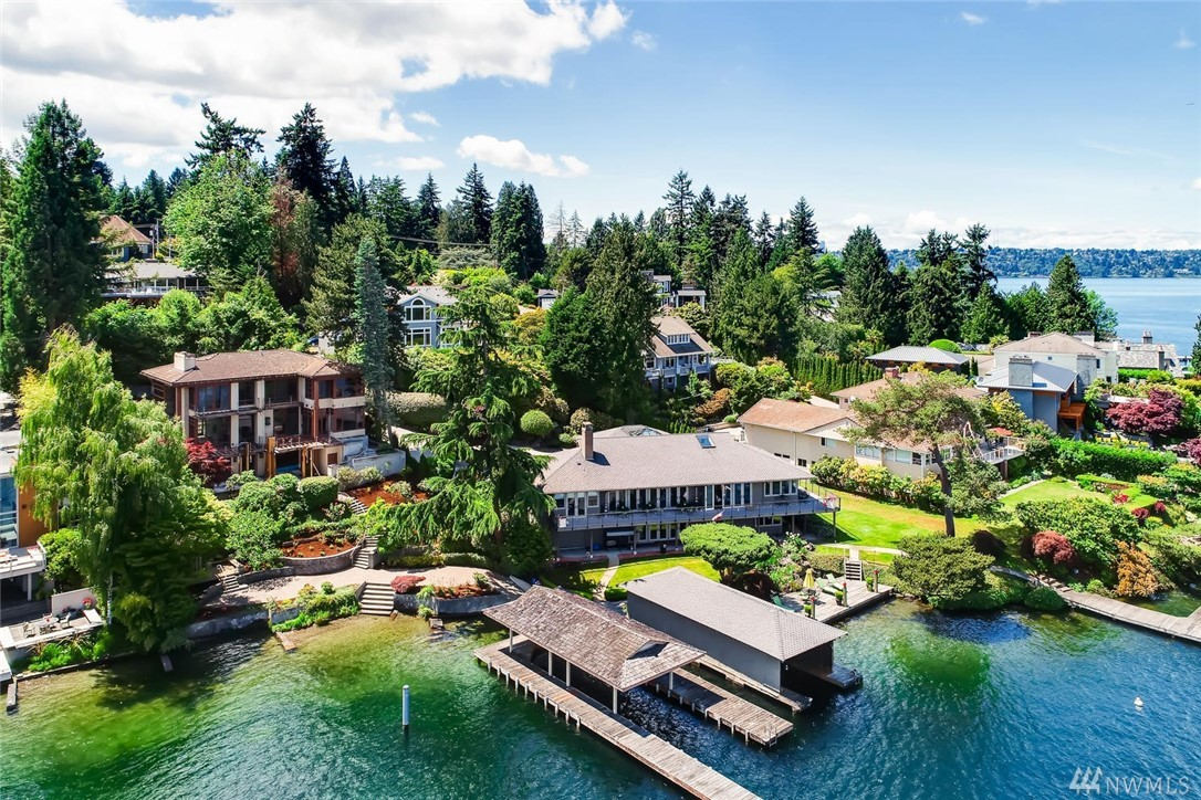 This Rare North End home sited on half acre & 84 feet of magnificent waterfront. Private gated drive leads to lush landscaping and beach side gazebo. You will love the timeless Modern design that exudes sophistication with soaring ceilings. U shaped covered dock moorage.  Architectural plans for remodel & addition are approved and permit is ready now for contractor to begin. Seller has contractor who can complete the dream remodel or you can choose your own. Ready for your designer touches.