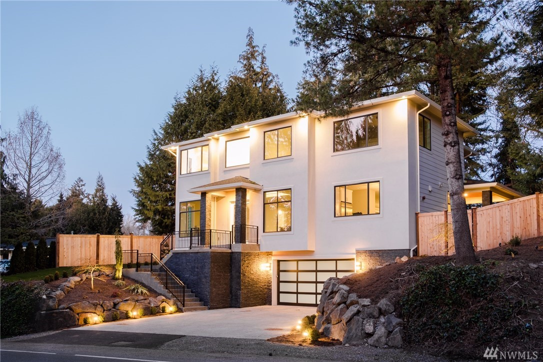 Mercer Island Stunning New Construction. Luxury finishes throughout! Gorgeous details & perfect floorplan. Upon entering the front door you'll be impressed by the tall ceilings. Features include; Chef's kitchen w/professional appliances & large island, Extravagant Master suite, Carrera Marble-clad master bath w/enormous shower, soaking tub, & heated floors. Office/Guest room, & full bath on main floor. Entertainment room w/bar. Smart Wi-Fi features. A/C. Covered patio. 4 car garage w/E-car wire.