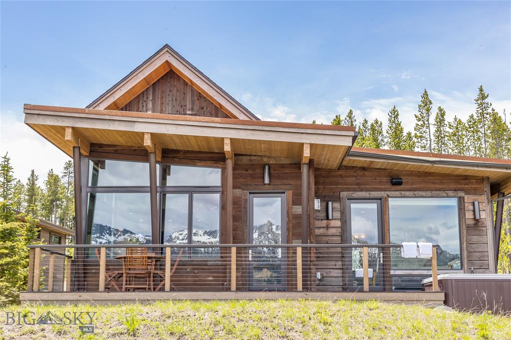 Nestled in the heart of Moonlight Basin, this sophisticated mountain modern cabin offers expansive view corridors, while groomed ski trails located just steps from this cabin ensure convenient ski-in/ski-out access down to the Madison Village. Floor to ceiling windows truly bring the outside in, while refined finishes, custom features, and contemporary lines collide to create very intimate, yet comfortable spaces. This open floor plan, complete with vaulted ceilings and 4 bedrooms make this cabin the ideal retreat to share your memories in the mountains with your family and friends.