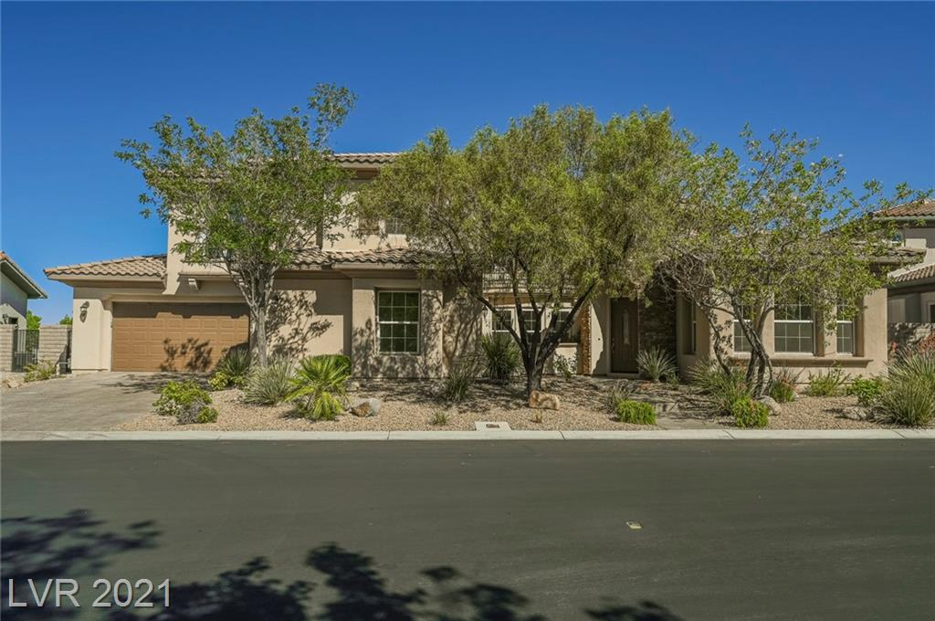 This tastefully remodeled home must be seen to be fully appreciated! 5 bedrooms, one is attached Casita plus another bedroom with en-suite, meaning 2 1/2 baths down. Fashionable wet bar and mini fridge splits the living & dining room spaces, large open family area next to the perfect office space. Luxury is the only way to describe the huge master suite, master has split vanities, two toilets, walk through shower behind your two person soaking tub and finished with an unobstructed view of the Las Vegas Strip off the large balcony............ Mark it down to see soon
