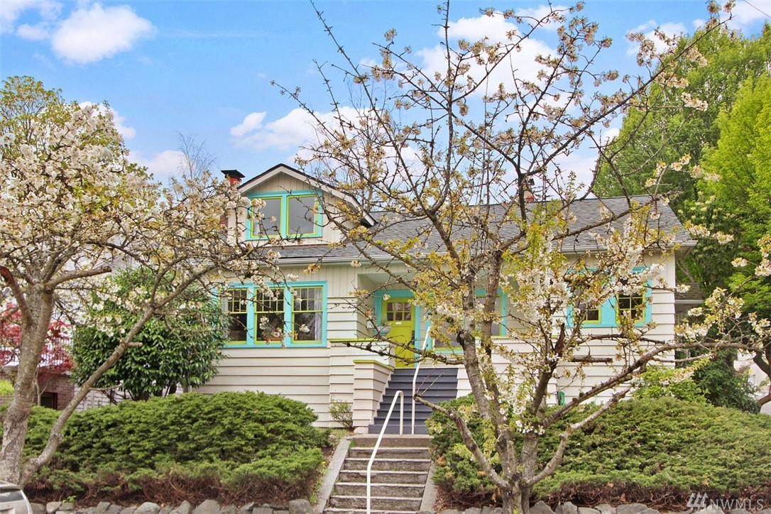"Back on the market (due to buyers non-performance).  Their loss is your gain! A sweet vintage 1919 Craftsman Bungalow in Ravenna, across the street Third Place Books, walk to Whole Foods, UW & new Light Rail Station. Hardwood floors, wood-burning fireplace, mullioned windows, remodeled kitchen and unique center-entry ""great room"" is perfect for greeting guests, formal dining room or home-based occupation. High-ceiling basement & detached garage for future improvements + corner lot w/alley."