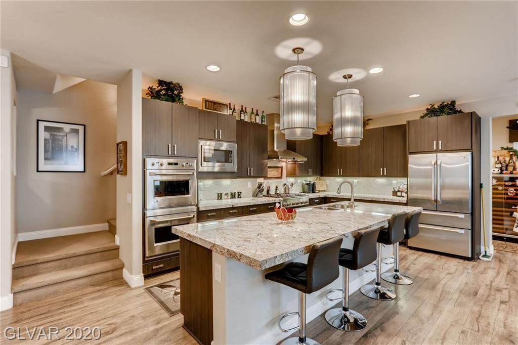 Stunning formal model home! This 5bdrm, 4ba home, 3690sf w tons of upgrades. Sparkling pool. Rooftop deck w a fireplace. Huge bedrooms.  Chef's kitchen is absolutely gorgeous, GE Monogram stainless steel appliances, upscale fixtures above a huge center island, high-end countertops, an enormous pantry & ample storage in the richly hued cabinetry. There is a loft w a wet bar, perfect for even more entertaining space. Hurry before this home is gone!