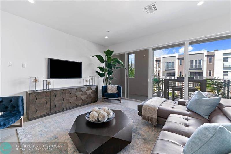 """DEVELOPER CLOSEOUT! ONLY A FEW LUXURY TOWNHOMES REMAIN! NEW Ultra-Stylish, spacious  2 Bed / 2.5 Bath plus Den/3rd Bdrm. Great attention to finishes, design and detail not to be seen at this price in East Ft Lauderdale. Luxury and Privacy in the Heart of it All; Beach, airport, fine dining, shopping, entertainment, and vibrant Las Olas Blvd. Pool, Dog Park. Low HOA's. Move-In Ready - Immediate Occupancy. Modern Elegance. Only 10% Down. NOW""""S THE TIME! Was $592,990"""