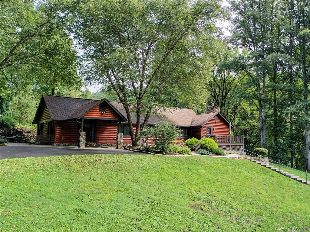 """Meticulously maintained - This inspiring estate is a Must See! Only 5 minutes to Parkway & Sylva & 8 miles to Waynesville, this estate has executive finishes throughout. Main residence offers over 3,000 sq.ft. of true one-level living and easy access. Featuring an extra-large master """"dream"""" closet, chef's kitchen w/ custom Hickory cabinets and high-end appliances, huge great room, walnut floors, 4 bedrooms (2 suites), 3 full baths, laundry room & lots of storage! Tons of rockwork, amazing koi pond w/ waterfalls, office building (wired w/ ethernet), oversized 3 car Garage w/bonus room & guest house w/ screened porch, deck, 2 bedrooms and full bath. Extras include 8.28 private acres, large pasture, campsites, unbelievable security features, solar water, cameras, firepit, new septic system (2019), vegetable gardens, fruit trees and more!"""