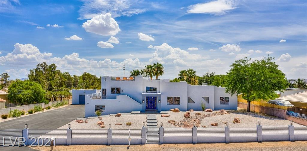"""*NO HOA* Welcome to The Fortress. one-of-a-kind modern luxury compound. Luxury living with no HOA? Sitting on 1.14 acres. Unique insulated """"ice-block"""" concrete construction makes this home virtually soundproof, energy efficient, & bullet proof! Pristine location, just ten minutes from T-Mobile Arena & Allegiant Stadium. Large primary bedroom separate from others with sitting area & huge walk-in closet. Primary bath features large steam shower with 4 showerheads/6 body jets. Finished RV garage that can double as your very own space for Golden Knights watch parties. Electric gated entrydriveway with space for all your guests. 50 AMP plug in for RV & toys. Private high efficiency well (2019) & septic. Recently renovated w/ newer roof (2019). Huge great room & large secondary bedrooms. Custom carved oak doors. Kitchen with subzero & wolf appliances. Rooftop deck boasts 360 degree mountain & Strip views. Backyard has room to roam with nice shade trees & parklike setting.Zoned for horses."""
