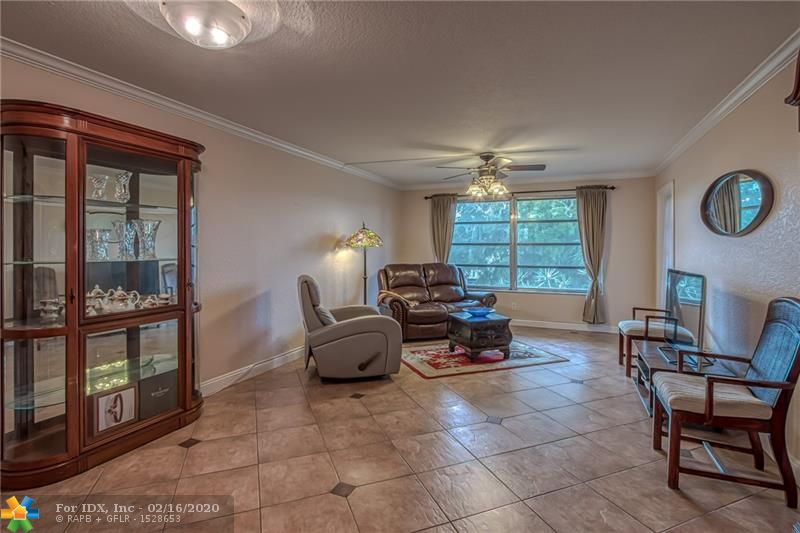 This condominium will not last - only 3 available. Third floor (top floor) 1 bedroom / 1.5 bath unit overlooks manicured gardens and heated swimming pool. Kitchen has been updated with solid wood cabinets, granite counters and newer appliances. Updated bathrooms. Ceramic tile in public areas and carpet in bedroom. Fully enclosed balcony can serve as a study or be used as screened outdoor space. Kings Park is a quiet community centrally located between Coral Heights and Coral Ridge Country Club, just 10 minutes from the beach.
