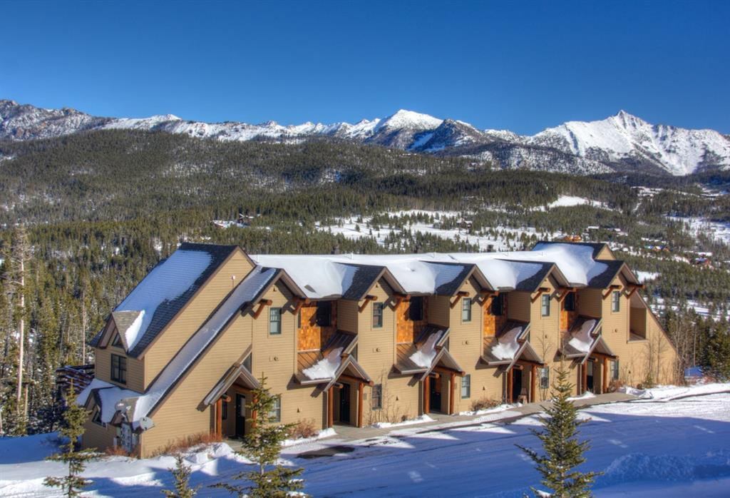 This beautifully upgraded, ski-in/ski-out townhouse located in Moonlight Basin offers 3 bedrooms and 3.5 bathrooms. This large end unit boasts a terrific ski-in/ski-out location, panoramic Spanish Peaks views, 2 sunny decks (one that is a wrap around deck, and one that offers a hot tub), and easy walking distance to the Moonlight Lodge. The property has been professionally decorated from top to bottom and shows beautifully. All 3 bedrooms are en-suite, and the property has a fantastic rental history. Sold fully furnished and turn-key.