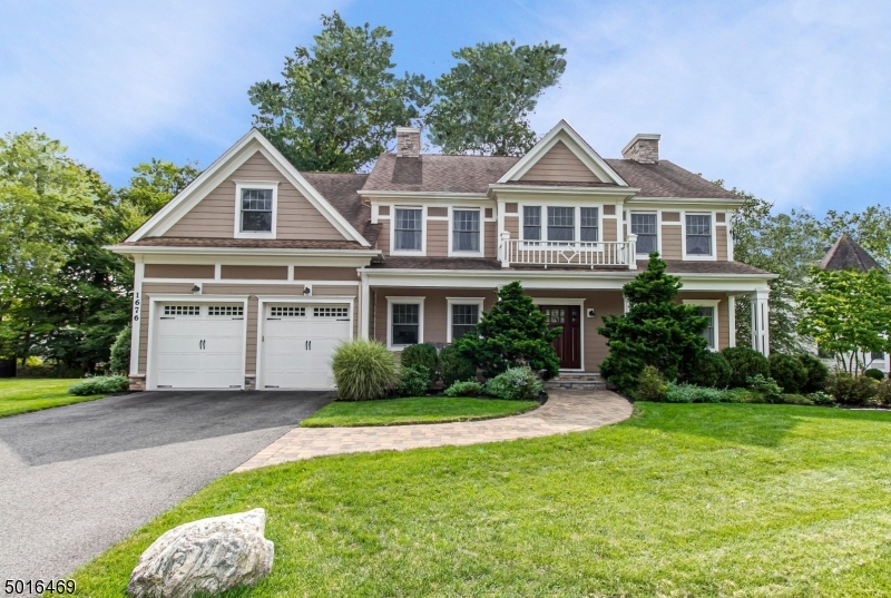 Must see pristine 4 bdrm 2.1 bth Colonial built in 2009 by Needle Point Homes. Private drive, set back on .62 acres, stunning curb appeal. Features include a grand 2 story foyer, exceptional gourmet kit. w/lg center island, SS appl, sliding glass doors to backyard patio, family rm w/gas FP, built in sound system, bright LR, elegant formal DR & coveted 1st flr office.  The 2nd flr boasts a sprawling MBR suite w/2 WI closets, sitting rm, mstr bth/2 sink vanity, Jacuzzi tub & shower stall w/bench, 3 bdrms w/double dr closets & lg laundry rm w/sink & cabinets.  Hardwd flrs thruout home, wall edges are softly rounded.  A huge basemnt w/high ceiling has endless possibilities.  Enchanting & tranquil prof. landscaped property.  Convenient to great schools (full day Kindergarten), Ponderosa Park & NYC transportation.