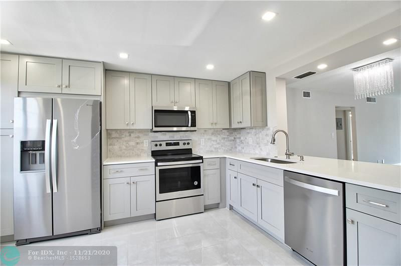 Completely renovated 2 bedroom/2 bath corner unit with great pool views in a quiet part of Wynmoor.  The corner unit offers a larger kitchen with privacy and bigger bedrooms with lots of windows.   Everything is new: HVAC, electrical panel, kitchen, baths, closets, floors, fixtures, paint, everything!  Fully permitted and nothing to do but move in.  This 55+ community has it all:  golf, pools, tennis, theater,  fitness center, clubhouse, courtesy bus, library, basketball courts, shuffleboard and so much more!  This is the one you have been waiting for.