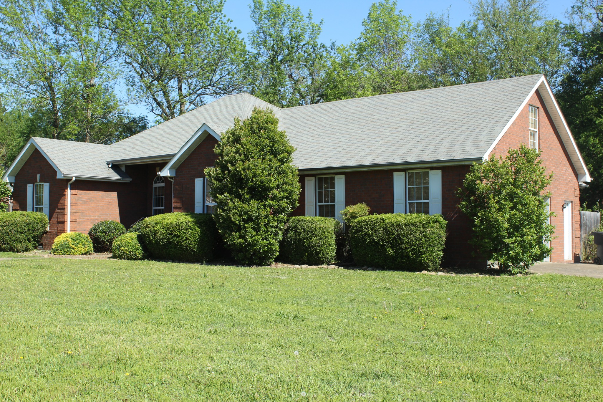 Established neighborhood, convenient to shopping, schools, interstate, one level brick home situated on large corner lot, fenced private backyard, mature trees, home features 3 bdrms, 2 baths,dining room w/trey ceiling, master bth w/trey ceiling and patio doors leading to deck, Living Room w/gas fireplace & builtin shelving, bonus room above garage, extra closets for storage. Estate Sale! Property being sold as-is.