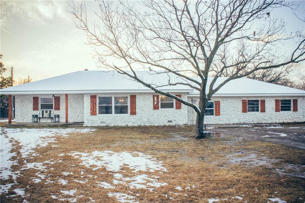 Beautiful, farmhouse chic home just hit the market in Shawnee!! This stuning home features 3 bedrooms, 2 bathrooms and just over 1900 sq ft of living space. This recently remodeled home features an open concept living area, new owners suite bathroom, and luxury vinyl plank flooring. The kitchen comes equipped with a farmhouse sink, beautiful subway tile and an island for extra work space. This trendy home also boasts a large laundry/mudroom and a dedicated, fenced back yard space perfect for a play area or for your furry friends. During the summer, entertain in style in double dining areas or relax at sunset on the covered back patio. This home also comes equipped with an oversized 1 car garage with room to work on your favorite project. Located in the Grove school district with options to attend North Rock Creek Public Schools.