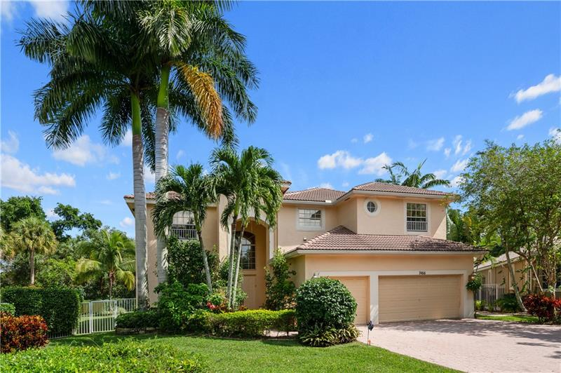 Beautiful home in Coconut Creek easy Access to ALL Highways. Home sits on extra-large corner lot, gated community Country Woods. The largest model & lot in the community. Home features 5 spacious bedrooms & 4 1/2 baths. The amazing 2nd floor master has stunning views of custom pool area, custom closet built-ins & has a private attached den. Large loft upstairs surrounds the other 3 upstairs bedrooms & laundry room, leaving no space unused. High ceilings give the home an open feel. The family room features sliding doors offering plenty of natural light. 2 new a/c units. Downstairs the large guest suite & cabana bath lead to the spectacular pool area. The luscious backyard has a tropical & private ambiance featuring oversized custom pool/spa/sun shelf. Great for entertaining. 3 car garage