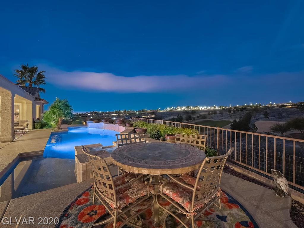 This is a one of a kind, extremely private property. Sweeping views of 1st, 9th, 10th & 18th fairways, LV Strip & Mountains. Concord Model includes additional window wall in dining rm overlooking backyard utopia, which includes gazebo, fireplace, outdoor kitchen & European style garden. Interior expansion includes: laundry rm, walk in pantry, 2 bay windows. Kitchen includes 2 ovens, convection/microwave & pull out drawers. Location is everything.