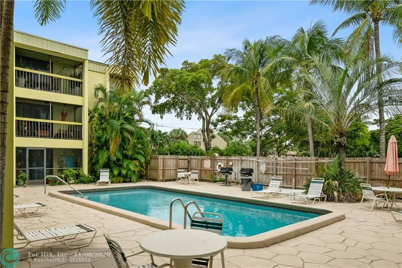 Boutique Condo in the heart of Wilton Manors.  This 2/2 condo is located in a prime location and has a full size washer and dryer! Well maintained unit but would ideal for a complete renovation. Sliding glass doors to your screened in balcony and exterior catwalks which overlook the pool and bbq area.  Walk across the street to Stork's Bakery for a quick delicious meal. 2 parking spaces available, no restrictions on leasing immediately, and one small dog up to 15 lbs or two cats ok.