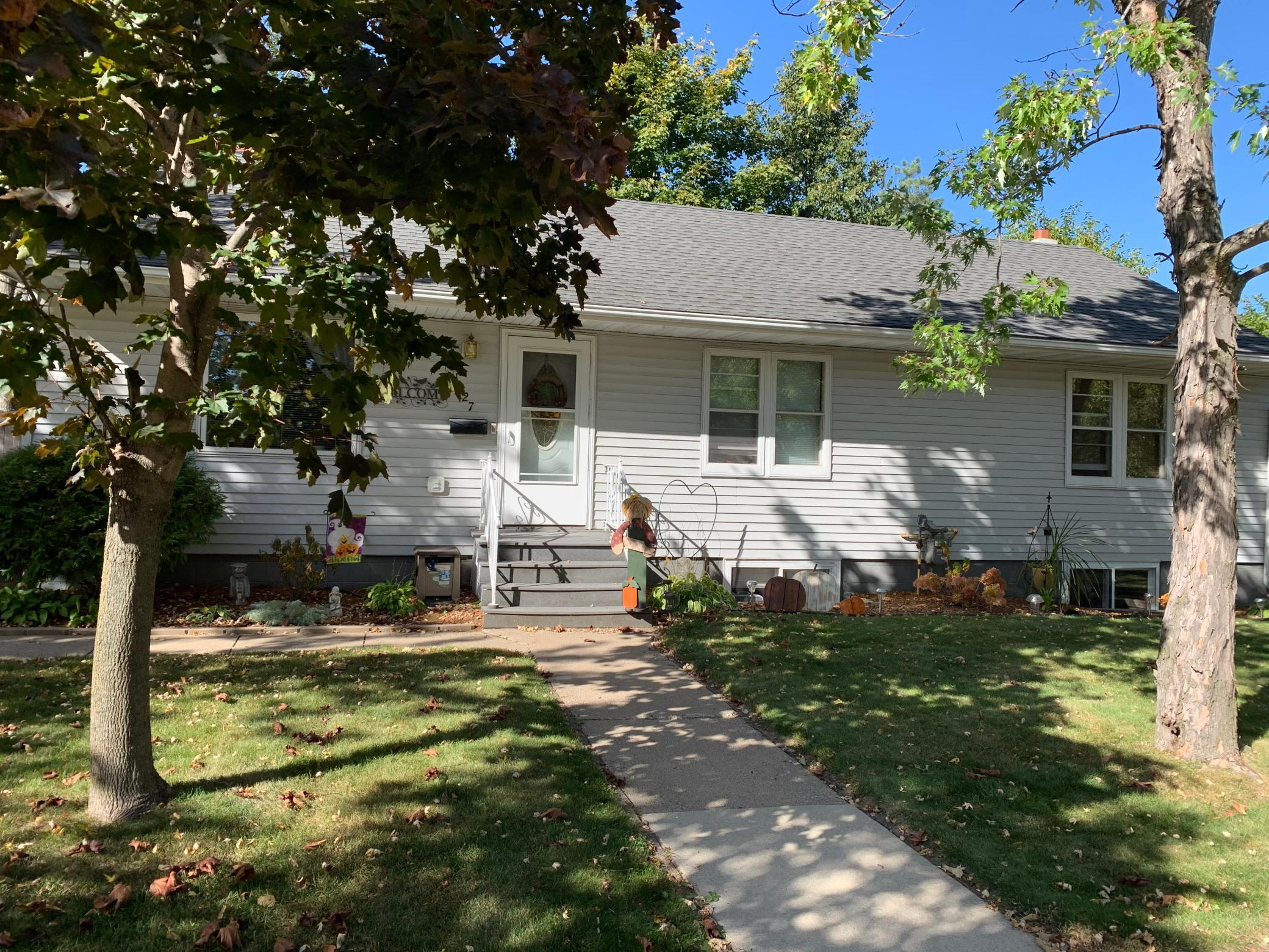 Great opportunity to own a wonderful rambler in convenient south side location. 2 Main floor bedrooms with natural hardwood floors as well as main floor laundry is handy for one level living.   Home has many updates! The lower level has its own entry,kitchenette and 3/4 bath for a mother suite or rental. Fenced in back yard and nice deck is beautiful for private entertaining! 4 car garage is a tinker dream!! This will not last long!!
