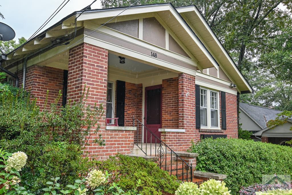 Truly a Five Points Classic, this circa 1949 Brick Cottage home is a gem in the very heart of Athens. The owner having an eye for architecture, well thought out floor plans and top of the line finishes make for an unbelievable renovation and addition! The exterior of this home is exactly the curb appeal you are looking for in a cottage with the perfect landscaping that accentuates the cottage style. People watching at its best with a cute front porch and swing. I love that the front door faces east inward toward the screen porch. In keeping with the character of this home you have a screen door for fresh air on those fall and spring days.  As you enter the home you will be amazed at how you can see from the front of the home all the way through to the back of the home. This is very unusual to have such an open floor plan in Five Points. You will enjoy having all of your living space on one level, with hardwood floors, tons of windows and every inch being completely renovated. It is a split bedroom floor plan with two bedrooms and one full bath on the left hand side of the home and the master bedroom being private in the back on the right hand side of the home. The kitchen is conveniently located in the center of the house and open to all of the living space: dining room, living room, breakfast room and great room/sunroom. Your guests will enjoy gathering around the kitchen and being able to visit multiple rooms at the same time.  Top of the line stainless steel appliances, double sink, drink refrigerator and multiple prep countertop areas make for a chef kitchen. Little details were not overlooked with spice cabinets and some floating shelves. Having a pantry is not a standard in these older homes but of course the owner reworked a space for there to be an ample size area for canned goods, larger mixing appliances and your dry goods. On one side of the kitchen you have a breakfast bar large enough for four bar stools and an oversized area for a breakfast table where
