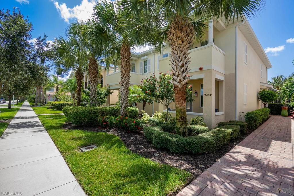 Beautifully upgraded Dublon Floor plan in amenity rich,Village Walk of Bonita Springs! Located in the newer phase of town-homes in Village Walk,this gorgeously appointed southern exposure town-home is located a hop,skip,& a jump from all of the amenities Village Walk has to offer! This fantastic property features two potential master suites,with one on the first floor and one upstairs,or three en-suite bedrooms! Upgraded crown molding, blinds integrated within the doors, stainless steel appliances,granite counter-tops,and lovely wooden cabinetry.Courtyard style rear exit, to your detached two car garage.Electric sunshade is located within the courtyard,to enjoy grilling in the warm Florida Sunshine!Gorgeous view of the lake from the balcony and lower patio, makes this property truly special. Wifi/Internet included! Partially Furnished! Amenities included at Village Walk; active town center with a resort-style pool, lap/lane pool, fitness center, tennis, pickle-ball, bocce ball, basketball, fitness center, car wash, fuel station, restaurant/bar, post office, & more. This community offers miles of walking paths & is just minutes to Florida's gulf beaches, shopping, & fine dining.