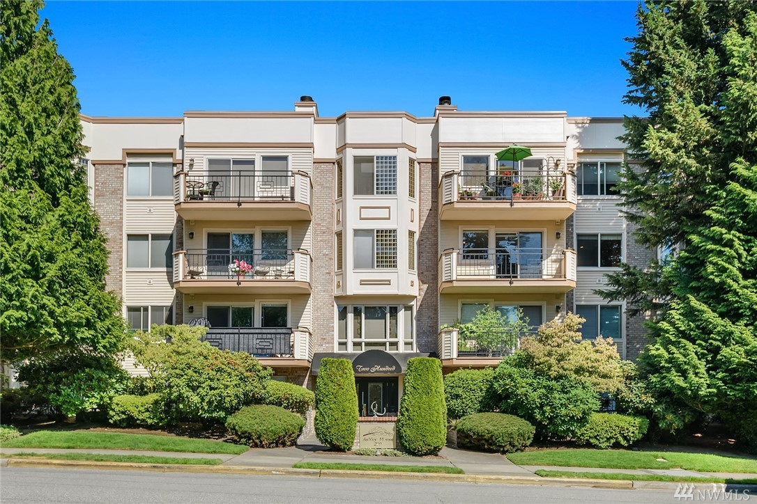 Live the Downtown Bellevue lifestyle! This 3rd floor 2 bedroom 1.75 bath condo is just blocks from all of the Shops/Dining/Activity but on a quiet street with a private balcony overlooking the trees and a partial lake view. Freshly painted with new carpet throughout, granite counters, and stainless appliances. Master ensuite with double closets, 2nd bedroom has french doors, built-in executive desk and Queen Murphy bed with drop-leaf table. Garage parking space w/storage and 2nd uncovered space!