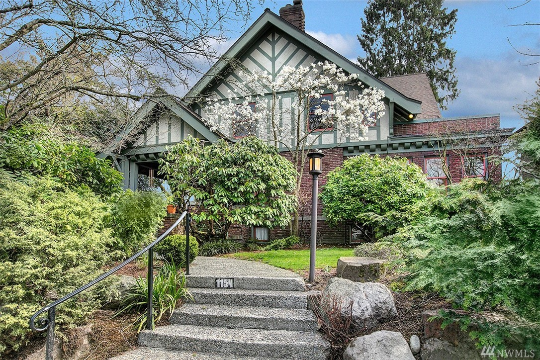 This treasured half-timbered home w/an exceptional lot is enhanced with mature landscaping and open space between neighboring homes. Classic spaces of beautifully executed proportions capture light and an element of surprise and grace. A veritable conservatory is found in the main floor library with windows on 3 sides and terrazzo floor. The central staircase w/stained glass windows on the landing leads to 2 more stories of private quarters. Fully finished lower level, garage & dreamy location.