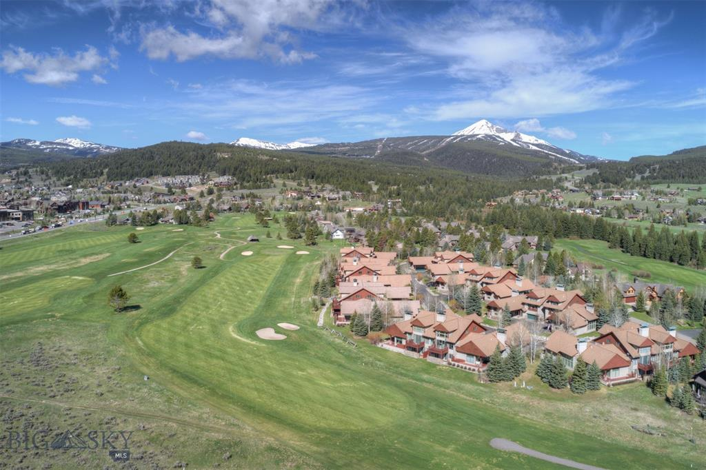 Gorgeous 3 bedroom, 2 1/2 bath Golf Course Condominium. Located on Big Sky's Meadow Golf Course, this property is easy walking distance to both the Big Sky Meadow Village Center and the Town Center. Cross Country ski trails are right out your back door in the Winter. Two bedrooms and 1 bath on the lower level of the condominium with an additional area in the basement for a play room or media room. The master bedroom and bathroom are all to itself on the upper level with a loft space. The main level holds the kitchen with an open floor plan and vaulted ceilings in the great room. There is an additional den/office on the main level. Large windows throughout, beautiful architecture and a 2 car garage.