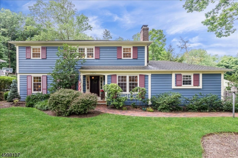 Welcome home to this 4 Bedroom, 2 1/2 Baths Custom Colonial, perfectly situated on almost a 1/2 acre w/ a large level lot. Updated Baths & Kitchen. Perfect location to schools, town, train & highways. Desirable cul de sac street. Excellent neighborhood. Enjoy neighborhood block parties & book clubs! Backyard has a park-like setting with wooded view. Inviting Floor Plan, 1st Floor boasts a custom eat in kitchen with granite counter tops and center island. Wood burning fireplace in family room, Large Living Room & Dining Room. First floor Laundry room for convenience, 2nd floor has 4 bedrooms & a bathroom including a spacious Master Bedroom and master bathroom.  Plenty of closet space. Added bonus is a finished full basement, w/ plenty of storage. A/C & Furnace 3 yrs old. Large yard w/ patio. Excellent schools.