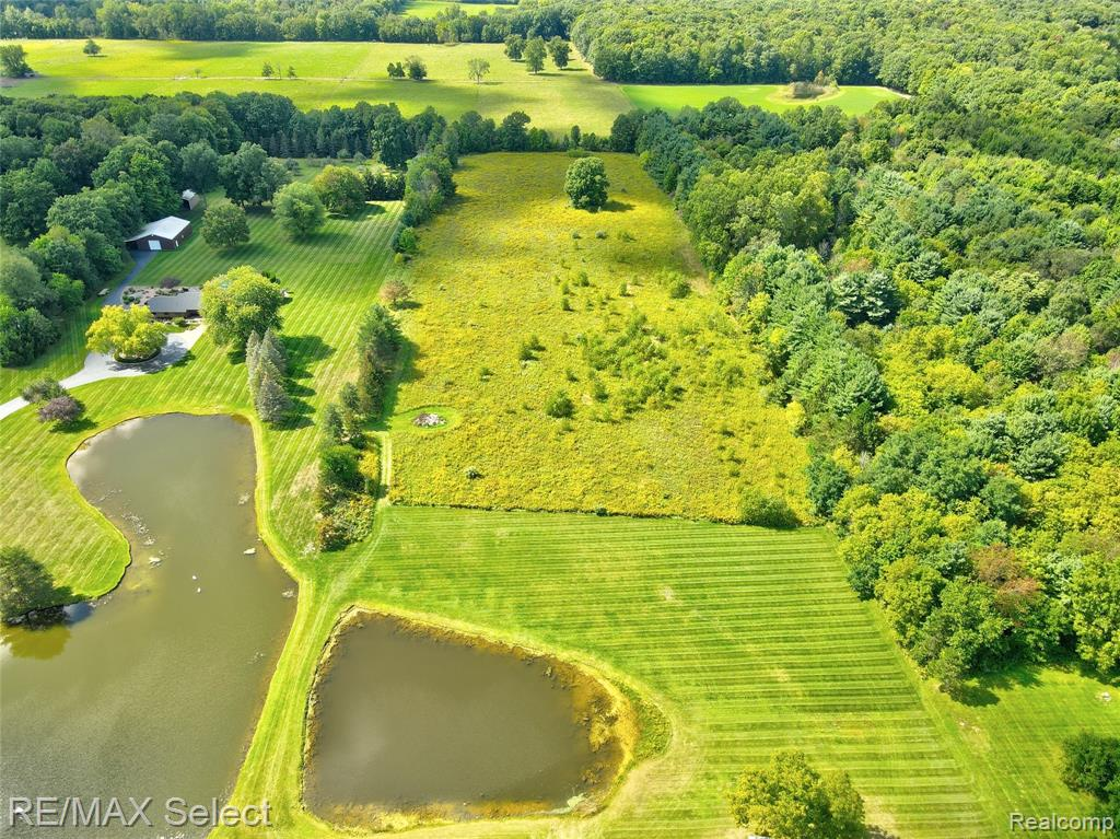 Beautiful 10 acre parcel is perfect for your new custom home. Wonderful hunting property.  Great location in Davison with a large pond will make for a gorgeous view!