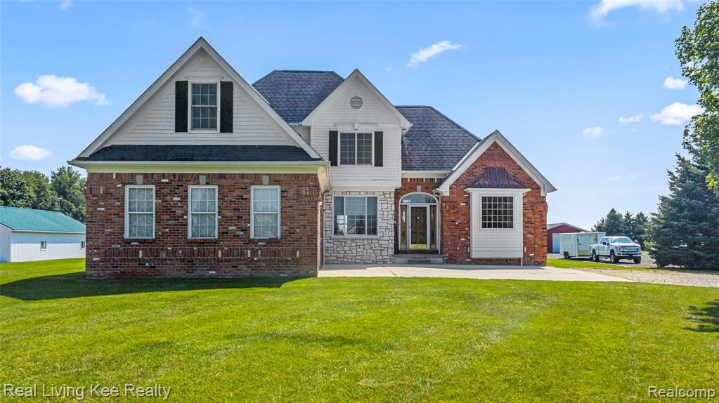 Live, work and play on this wonderful estate sized lot that includes 4B/2.5B home, 34'x48' pole barn with Armada schools.   Amentities are endless with inlayed wood floors, first floor master suite, new Anderson windows 2018, new A/C and hot water heater 2018, paint and carpet 2021, spacious brick patio, pole barn is insulated w/natural gas and 220v power.  The well planned layout has an open concept between kitchen and greatroom that features a floor to ceiling stone fireplace.  Lower level is roughed w/ recreation room including a bar area, full bath, office and tons of storage space.