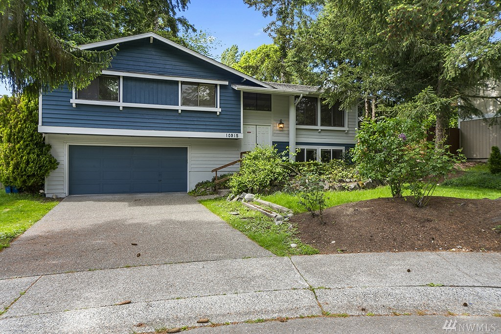 Newly updated home in the heart of Redmond's Education Hill offers great privacy and the safety of a cul-de-sac. A few steps away, a private path leads to Norman Rockwell elementary. The neighborhood also adjoins a park. The house is split level, with mother-in-law suite downstairs including bedroom, bath and den w/ fireplace. Upstairs master + additional bedrooms for a total in the home of 5 bedrooms & 3 baths. A beautiful kitchen and a spacious back deck make for great BBQ'ing summer evenings.