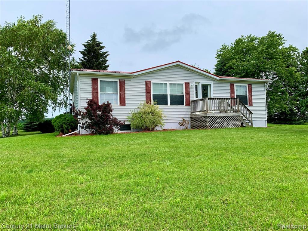 Nice Country setting.  Manufactured home built-in 2003.  3 bed 2 baths, nice basement 2x8 wood foundation.  Large hay barn located on 5 acres.  New roof 2020. Property Has Income from Windmill Rents/ Excelon #2,000 Annually. and DTE $600 1 year years 6-10 $750  11-15 Years $1,250 Annually. through 12/31 2031.