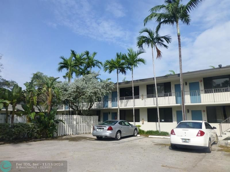 "Lowest priced unit at The Woods.  Mostly original condition offers the savvy buyer the opportunity to upgrade to their own taste.  Air con'ditioner installed in 2012.  Impact windows.  Building exterior was just totally redone and assessment has been paid in full.  Fabulous location in an intimate complex of just 46 units.  Short distance to Wilton Drive's restaurants and nightlife.  Pool is surrounded by lush tropical landscaping.  2 pets allowed up to 65 pounds total.  MOTIVATED SELLER SAYS ""BRING OFFERS'"