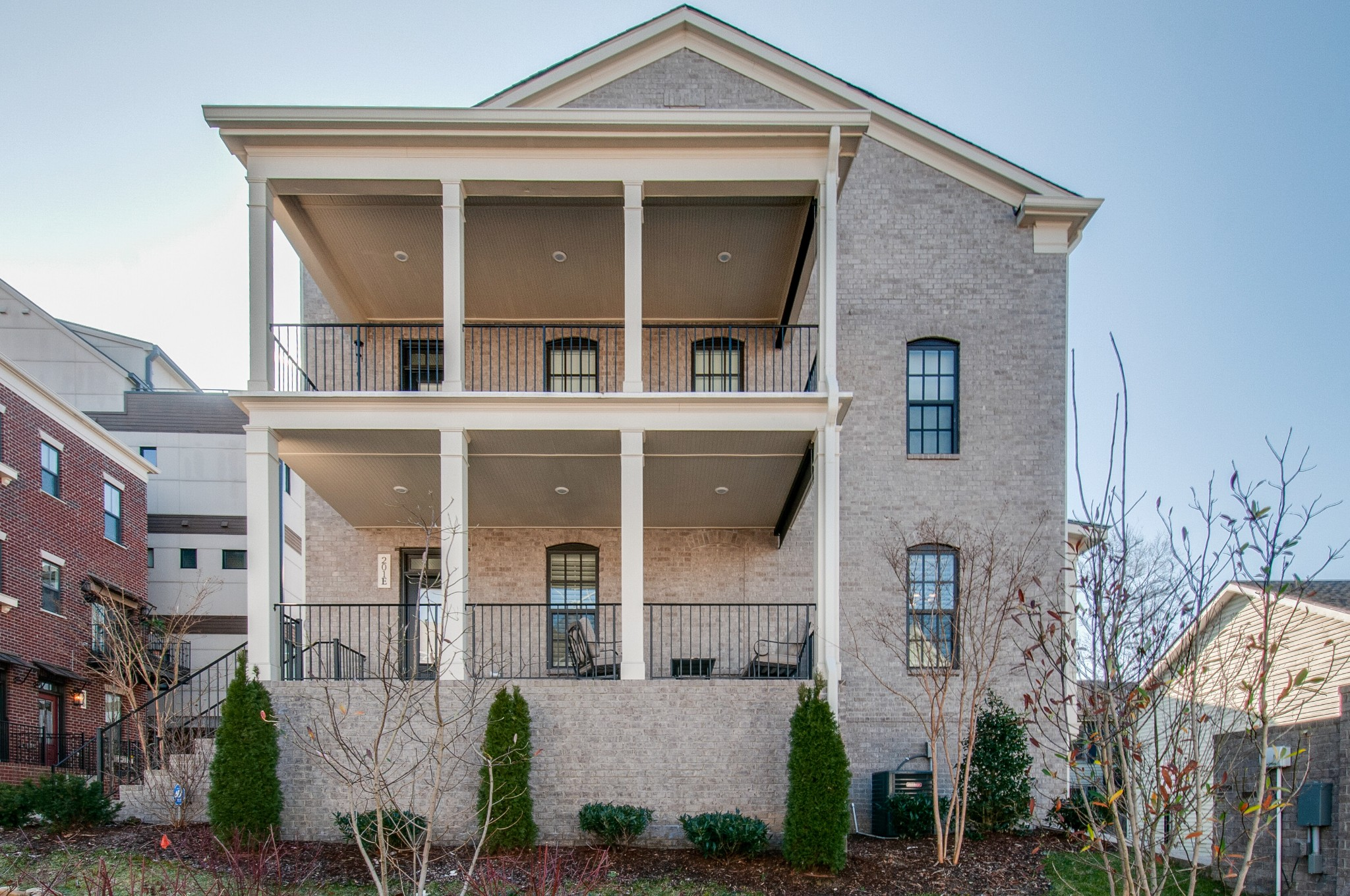 Fantastic location adjacent to Vanderbilt! This light filled end unit rowhome has an enviable, extra large owner's suite. Flex room could be a 2nd bedroom/office. The attached tandem 2 car garage has space for a Pelaton. Enjoy New Orleans style double porches year round. Low traffic street yet less than .5 mile to Centennial Dog Park. Unexpected details include real wood built in shutters & bookcases and a custom dining banquette. Low maintenance & perfect for a lock & leave lifestyle