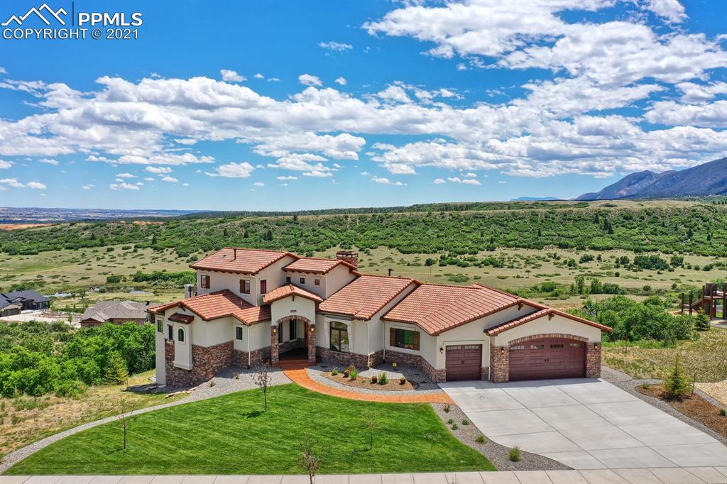 This Stunning Home Is Gracefully Poised At The Top Of The Mesa~Enjoy A Breathtaking Sunrise Over The Lake And Glowing Sunsets Over The Mountains~Glamorous Without Being Pretentious, You Will Appreciate Every Detail Of This Lovely Home~Kitchen Is A Chefs Delight With High End Thermador Appl, Huge Walk In Pantry Plus A  Butlers Pantry~Enjoy Morning Coffee On The Deck With Peaceful Mountain And Lake Views~Warm And Inviting Family Rm With Coffered Ceiling, Rustic Stone Fireplace, Built Ins, Wall Mounted TV And Sliding Doors That Open To Deck~Master Ste Is Tucked Away In Its Own Separate Wing Of The Home W/ Panoramic Vws From Both Inside And Out On The Deck~Spectacular, Resort Style, Master Bath W/ Heated Soaking Tub, Walk In Shower, Dbl Vanities And Walk In Closet~Upper Lvl Office W/ Its Own Deck Is The Perfect Secluded Retreat~The Family Rm Is An Entertainers Dream With State Of The Art, Climate Controlled Wine Room, Custom Wood Bar, And Rustic Stone Fireplace~Family Rm Walks Out To Stamped Concrete Patio With Sweeping Views Of Mtns And Lake~Work Out Room, 3 More Beds, 2 Baths, Storage Rm Complete The Lower Lvl~Uncompromising Outdoor Living Spaces Both Up And Down W/ Plenty Of Room To Relax As You Take In The Postcard Setting And Unobstructed, Scenic Vws~No Expense Spared In This Home: Superb Location, Outstanding Vws, Tile Roof, Stamped And Stained Concrete Patio, Composite Deck, 8' Doors, Wrought Iron Railing, 2 Commercial Grade H20 Heaters, 3 Furnaces, 3 A/C Units, Handscraped, Hardwood Floors, Venetian Textured Walls, 3 Interior Fireplaces And 2 Exterior Firepits, Natural Gas Grill, Control 4 System With Speakers Throughout Most Of The Home, Internet Booster, 2 Internet Lines, Nearly 1000 Sq Ft Garage And SO Much More~Easy Access To I-25~Approx 40 Miles To Denver Tech Center, 5 Miles To USAFA, And 20 Miles To Downtown Colorado Springs~This Is A Once In A Lifetime Opportunity To Own Your Own Personal Sanctuary And Have The Quality Of Life You Have Been Waiting For!