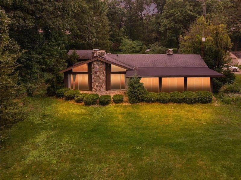 Well and driveway will be shared by neighbor who is the current owner of the subject property.  2 beautiful rock fireplaces.  Open floor plan.  Pristine sandy beach area.  82 acre lake. Sits about 300 feet back from Crispell Rd. Enclosed sun porch overlooks lake.  All sports lake.