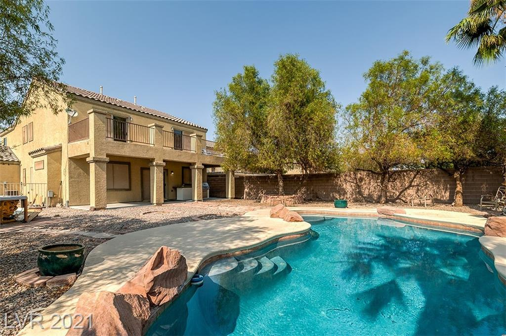 **ONE-OF-A-KIND STUNNING EXPANSIVE HOME**This home features spacious 4 bedrooms + den (easily used as a 5th bedroom)/ 3 baths/ 3 car garage/ and a separate gate for RV Parking**Imagine entertaining your guests and family at a Resort-Style Backyard with pool and waterfall grilling and having a mai-tai on the Built-In BBQ under the massive covered-patio with ceiling fan to keep you cool**Each room is equipped with ceiling fans and solar screens all throughout the house**Come out to the extended balcony for your morning coffee from your master and second bedroom**All upstairs promotes brand new carpet and interior including the garage has been freshly new painted**Home is located within 2 miles to freeways, shops, restaurants, and bus stops**MAKE AN OFFER NOW, THIS WON'T LAST**