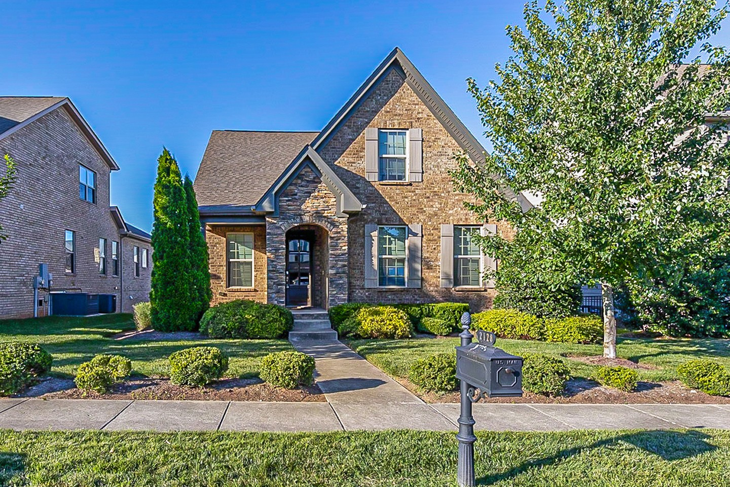 Built in 2014, this Thompsons Station two-story home offers a patio, granite countertops, and a two-car garage.
